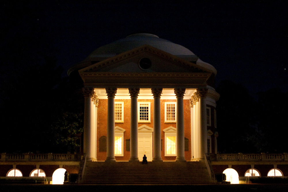 A student sits on the steps of the rotunda at the University of Virginia in the evening, Charlottesville, Virginia.