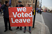 Vote Leave demonstrators protest waving European Union and Union Jack flags and placards in Westminster opposite Parliament on the as five days of Brexit debate begins on 4th December 2018 in London, England, United Kingdom.