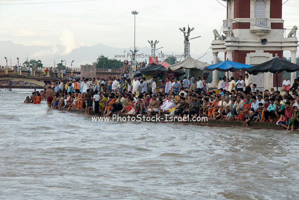 India, Uttarakhand, Haridwar Pilgrims bathing in the Ganges River
