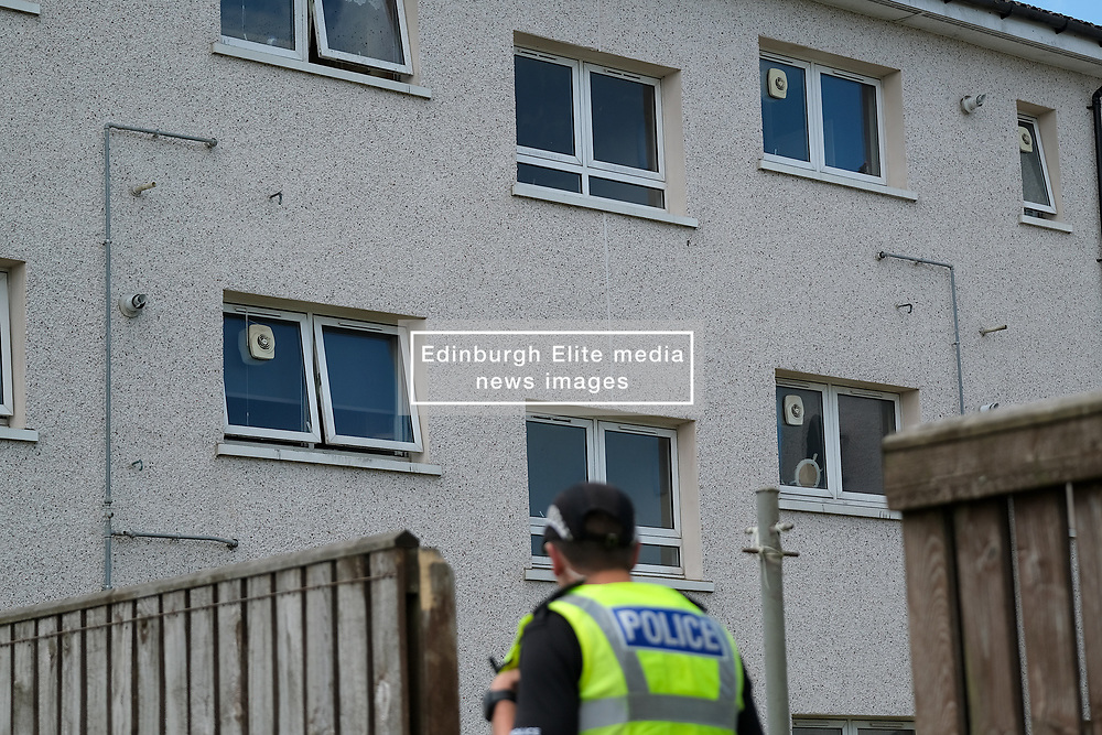 Murder Investigation, Blackburn, West Lothian, 13 June 2021<br /> <br /> A murder investigation is underway after a body was found in a flat in Mosside Drive, Blackburn, West Lothian at the weekend.<br /> <br /> The flat, just across the road from a filming location of the movie Trainspotting 2, is cordoned off and has a police presence.<br /> <br /> Alex Todd   Edinburgh Elite Media