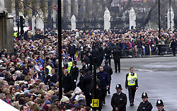 File photo dated 09/04/02 of crowds waiting for the procession carrying the coffin of Queen Elizabeth, the Queen Mother, to travel to Westminster Abbey from Westminster Hall. The Queen mother's funeral was the last royal funeral to be extensively televised in the UK. Issue date: Friday April 16, 2021.