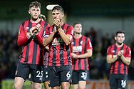 Bournemouth midfielder Andrew Surman and Bournemouth defender Jack Simpson applauds supporters after the EFL Cup match between Burton Albion and Bournemouth at the Pirelli Stadium, Burton upon Trent, England on 25 September 2019.