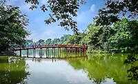 HANOI, VIETNAM - CIRCA SEPTEMBER 2014: View of the Huc Bridge, a famous landmark over the Hoan Kiem Lake, in Hanoi.