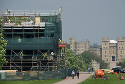 © Licensed to London News Pictures. 08/05/2018. Windsor, UK. A large stand (L) containing television studios is being built on The Long Walk near Windsor Castle ahead of the Royal Wedding of Prince Harry and Meghan Markle. With 12 days to go there is lots of activity in and around the grounds of Windsor Castle. Photo credit: Peter Macdiarmid/LNP