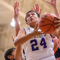 111913       Cable Hoover<br /> <br /> Miyamura Patriot Anthony Lee (24) gets past the Aztec Tigers for a layup Tuesday at Miyamura High School.
