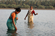 India, Goa, Two local woman bathing in the river