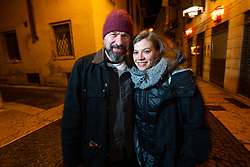 BMW's Roland Stocker and Sarah in downtown Verona after dinner during Motor Bike Expo (MBE) bike show. Verona, Italy. Sunday, January 19, 2020. Photography ©2020 Michael Lichter.