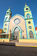 Facade of the colorful Our Lady of Fatima Church in the central historic district of Coatepec, Veracruz State, Mexico.
