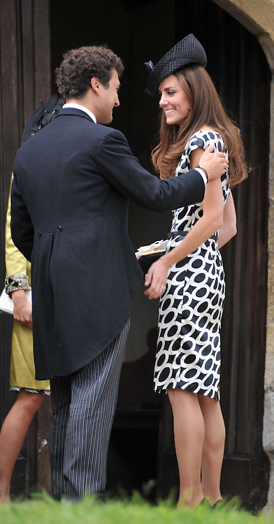 The Wedding of Sam Waley-Cohen to Miss Annabel (Bella) Ballin at St Michael & All Angels Church, Lambourn, Berkshire on 11th June 2011.<br /> Picture Shows:-HRH THE DUCHESS OF CAMBRIDGE & THOMAS VAN STRAUBENAZEE