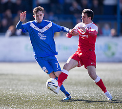 Montrose Graham Webster tackled by Brora Rangers Steven MacKay and the Brora Rangers player got a red card from ref McKendrick. <br /> Montrose 3 v 1 Brora Rangers, Scottish League Two play-off second leg, today at Links Park, Montrose.