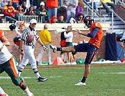 Oct 30, 2010; Charlottesville, VA, USA; Virginia Cavaliers punter Jimmy Howell (8) kicks the ball during the game against the Miami Hurricanes at Scott Stadium. Virginia won 24-19.  Mandatory Credit: Andrew Shurtleff-US PRESSWIRE