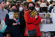 Young people hold banners at a rally in support of protestors in Hong Kong in Hachiko Square, Shibuya, Tokyo, Japan. Saturday November 16th 2019