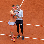 PARIS, FRANCE October 11.  Tímea Babos of Hungary and Kristina Mladenovic of France pose for a selfie with the trophy after their victory against Alexa Guarachi of Chile and Desirae Krawczyk of the United States in the Women's Doubles Final on Court Philippe-Chatrier during the French Open Tennis Tournament at Roland Garros on October 11th 2020 in Paris, France. (Photo by Tim Clayton/Corbis via Getty Images)