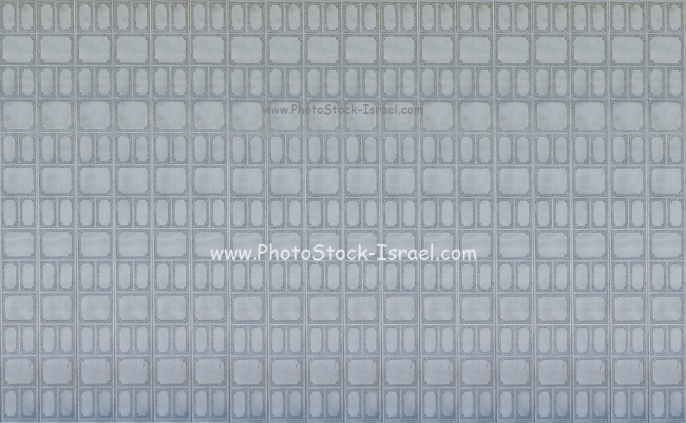 Digitally enhanced image of repeating wall decoration in gray