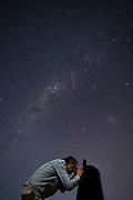 Man using telescope at Mamalluca Observatory, Vicua, Chile