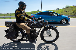 A passing car slows to photograph Shinya Kimura as he rides his Team-80 1915 Indian twin during the Motorcycle Cannonball Race of the Century. Stage-4 from Chillicothe, OH to Bloomington, IN. USA. Tuesday September 13, 2016. Photography ©2016 Michael Lichter.