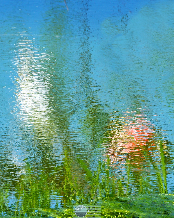 Abstract nautical water reflection created with boats captured reflecting in blue water