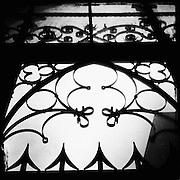 Ornate wrought iron adorns the windows of the Saint Bartholomeus Cathedral in Frankfurt, Germany.