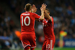 Bayern Forward Arjen Robben (NED) celebrates with Defender Rafinha (BRA) after scoring a goal during the second half of the match - Photo mandatory by-line: Rogan Thomson/JMP - Tel: Mobile: 07966 386802 - 02/10/2013 - SPORT - FOOTBALL - Etihad Stadium, Manchester - Manchester City v Bayern Munich - UEFA Champions League Group D.