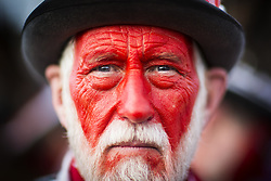 January 14, 2017 - Whittlesey, Cambridgshire, UK - Whittlesey UK. Picture shows a member of the Red Leicester Molly dancers at the 38th Whittlesey Straw Bear Festival this weekend. In times past when starvation bit deep the ploughmen of the area where drawn to towns like Whittlesey, They knocked on doors begging for food & disguised their shame by blackening their faces with soot. In Whittlesey it was the custom on the Tuesday following Plough Monday to dress one of the confraternity of the plough in straw and call him a Straw Bear. The bear was then taken around town to entertain the folk who on the previous day had subscribed to the rustics, a spread of beer, tobacco & beef. The bear was made to dance in front of houses & gifts of money, beer & food was expected. (Credit Image: © Andrew Mccaren/London News Pictures via ZUMA Wire)