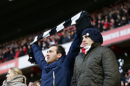 Charlton Athletic fan's protesting against Katrien Meire, the Charlton Athletic chief executive by wearing Black & White scarfs to ask the chief executive to spell it out to the fans in Black & White during the 1st half. Skybet football league championship match, Charlton Athletic v Nottingham Forest at The Valley  in London on Saturday 2nd January 2016.<br /> pic by John Patrick Fletcher, Andrew Orchard sports photography.