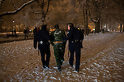 New Year's Eve (December 31) in Belgrade, Serbia. Parliament square and Pionirski Park. A drunk Serbian Soldier (or someone dressed in uniform) is escorted by Belgrade police to a bench to sober up.