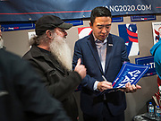 12 DECEMBER 2019 - DES MOINES, IOWA: ANDREW YANG signs a campaign sign for a supporter during the opening of his campaign office in Ames, IA. Yang, an entrepreneur, is running for the Democratic nomination for the US Presidency in 2020. He brought bus tour to Ames, IA, Thursday. Iowa hosts the the first election event of the presidential election cycle. The Iowa Caucuses will be on Feb. 3, 2020.        PHOTO BY JACK KURTZ