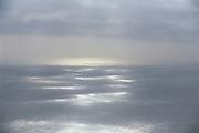 """Pacific cloud shadows,"" sunlight breaking through incoming fog on the ocean, Sonoma Coast, California"