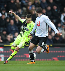 Jamie Paterson of Huddersfield Town (L) in action - Mandatory byline: Jack Phillips/JMP - 05/03/2016 - FOOTBALL - iPro Stadium - Derby, England - Derby County v Huddersfield Town - Sky Bet Championship
