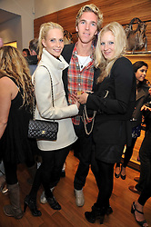 Left to right, POPPY DELEVIGNE, JAMES COOK and SAVANNAH MILLER at a party in aid of the charity Best Buddies held at the Hogan store, 10 Sloane Street, London SW10 on 13th May 2009.