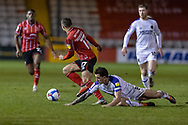 Lincoln City Forward Remy Howarth (17) beats Shrewsbury Town Midfielder Oliver Norburn  to the ball during the EFL Sky Bet League 1 match between Lincoln City and Shrewsbury Town at Sincil Bank, Lincoln, United Kingdom on 15 December 2020.