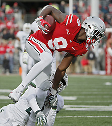 November 11, 2017 - Columbus, OH, USA - Ohio State Buckeyes wide receiver Binjimen Victor (9) grabs a pass while defended by Michigan State Spartans cornerback Justin Layne (2) during the third quarter on Saturday, Nov. 11, 2017 at Ohio Stadium in Columbus, Ohio. Victor would score on the play. Ohio State won the game 48-3. (Credit Image: © Barbara J. Perenic/TNS via ZUMA Wire)