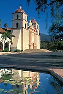 Front of the Historic Mission Santa Barbara Chapel reflected in fountain water, Santa Barbara, California
