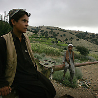 .20th August 2007.Tora Bora.A group of young boys and teenagers whose families have recently returned to the area sit and chat and play on an abandoned Russian tank at Tora Bora on the 20th August 2007. Tora Bora was one of the mountain hideouts of Osama Bin Laden and the Al-Qaeda fighters. It was destroyed during the battle of Tora Bora at the beginning of this recent conflict.  In the past weeks it has been the scene of a joint US and Afghan offensive against Taliban fighters who have moved back into the area....