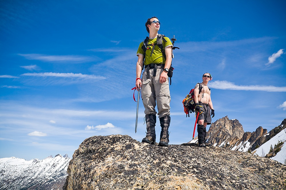 Brian Polagye (l) and Ian Derrington stand proudly holding ice axes on a boulder below Wallaby Peak, Okanogan National Forest, Washington.