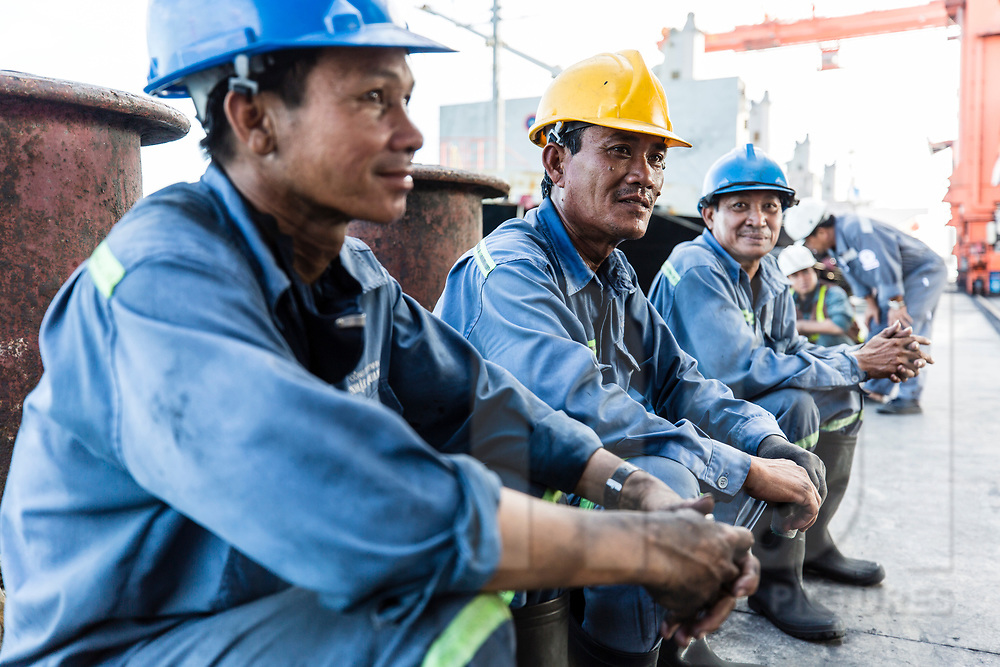 Workers at the dockyard of EVN Genco 3, Vinh Tan coal power plant, Vietnam, Southeast Asia