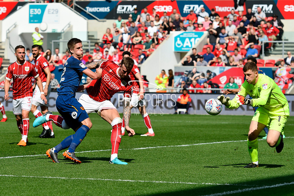 Markus Henriksen (22) of Hull City is challenged by Aden Flint (4) of Bristol City which allows Frank Fielding (1) of Bristol City to claim the ball during the EFL Sky Bet Championship match between Bristol City and Hull City at Ashton Gate, Bristol, England on 21 April 2018. Picture by Graham Hunt.