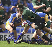 Reading, Berkshire, 20th April 2003,  ZURICH PREMIERSHIP RUGBY, The Madejski Stadium,  [Mandatory Credit: Peter Spurrier/Intersport Images],<br /> <br /> Zurich Premiership Rugby London Irish v Leeds<br /> Alan Dickens releases the ball before Chris Sheasby's lunging tackle