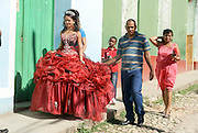 Cuba, Trinidad. girl dressed up for her fifteenth birthday