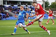 Barnsley midfielder Ryan Hedges (7)  gets in a cross past Peterborough United midfielder Louis Reed (11) during the EFL Sky Bet League 1 match between Peterborough United and Barnsley at The Abax Stadium, Peterborough, England on 6 October 2018.