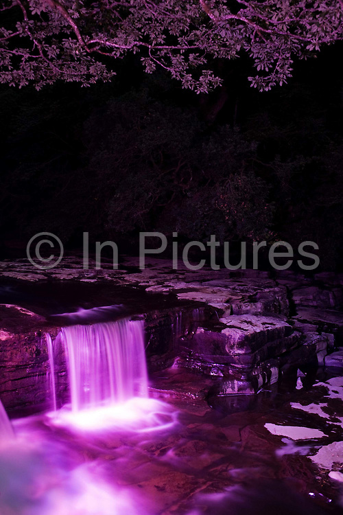 Floodlit river Clyde falls at New Lanark, the industrial revolution community village managed by social pioneer Robert Owen. New Lanark is on the River Clyde, approximately 1.4 miles (2.2 kilometres) from Lanark, in South Lanarkshire, Scotland. It was founded in 1786 by David Dale, who built cotton mills  and housing for the mill workers. Dale built the mills there to take advantage of the water power provided by the river. Under the ownership of a partnership that included Dale's son-in-law, Robert Owen, a Welsh philanthropist and social reformer, New Lanark became a successful business and an epitome of utopian socialism. The New Lanark mills operated until 1968 and is now one of five UNESCO World Heritage Sites in Scotland.