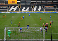 Hull City's Gavin Whyte is congratulated by Josh Magennis Greg Docherty and George Honeyman as he scores his side's second goal in the 60th minute to make it 2-0 with the scoreboard confirming the goal<br /> <br /> Photographer Lee Parker/CameraSport<br /> <br /> The EFL Sky Bet League One - Hull City v Bristol Rovers - Saturday 6th March 2021 - KCOM Stadium - Kingston upon Hull<br /> <br /> World Copyright © 2021 CameraSport. All rights reserved. 43 Linden Ave. Countesthorpe. Leicester. England. LE8 5PG - Tel: +44 (0) 116 277 4147 - admin@camerasport.com - www.camerasport.com