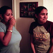 11/15/02<br />Angel's sister, Mildred, left, and his girlfriend, Amanda Ruiz, are overwhelmed at the sight of Angel who arrived home after midnight.