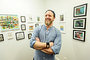 """Multi-disciplined artist Thomas Brown expresses himself during the opening reception for """"Thomas Brown: Drawings from the G Train,"""" Friday, Jan. 10, 2020, at Surface Noise in Louisville, Ky. (Photo by Brian Bohannon)"""