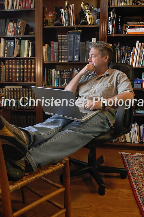 Author Clay Morgan pauses from writing in his library at his home in Clear Lake.   (Photo by Kim Christensen)