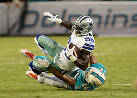 August 23rd, 2014, Miami Dolphins cornerback Cortland Finnegan (24) tackles Dallas Cowboys wide receiver Dez Bryant (88) during a game between the Miami Dolphins and the Dallas Cowboys at Sun Life Stadium in Miami Garden, FL NFL American Football Herren USA AUG 23 Preseason - Cowboys at Dolphins PUBLICATIONxINxGERxSUIxAUTxHUNxRUSxSWExNORxONLY Icon140823006<br /> <br /> August 23rd 2014 Miami Dolphins Cornerback Cortland Finnegan 24 Tackles Dallas Cowboys Wide Receiver Dec Bryant 88 during A Game between The Miami Dolphins and The Dallas Cowboys AT Sun Life Stage in Miami Garden Fl NFL American Football men USA Aug 23 Preseason Cowboys AT Dolphins PUBLICATIONxINxGERxSUIxAUTxHUNxRUSxSWExNORxONLY