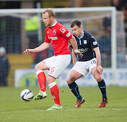 Ross County's Liam Boyce and Dundee's Paul McGowan. <br /> Half time : Dundee 0 v 0 Ross County, SPFL Premiership game player 4/1/2015 at Dundee's home ground Dens Park.