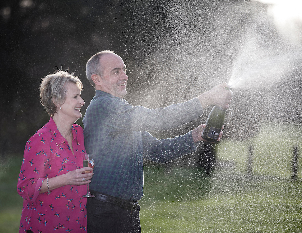 £33million Lotto winners David and Carol Martin both 54 from the Scottish Borders celebrate their massive win at the Dalmahoy Hotel near Edinburgh. Picture Robert Perry 13th Jan 2016<br /> <br /> Must credit photo to Robert Perry<br /> FEE PAYABLE FOR REPRO USE<br /> FEE PAYABLE FOR ALL INTERNET USE<br /> www.robertperry.co.uk<br /> NB -This image is not to be distributed without the prior consent of the copyright holder.<br /> in using this image you agree to abide by terms and conditions as stated in this caption.<br /> All monies payable to Robert Perry<br /> <br /> (PLEASE DO NOT REMOVE THIS CAPTION)<br /> This image is intended for Editorial use (e.g. news). Any commercial or promotional use requires additional clearance. <br /> Copyright 2014 All rights protected.<br /> first use only<br /> contact details<br /> Robert Perry     <br /> 07702 631 477<br /> robertperryphotos@gmail.com<br /> no internet usage without prior consent.         <br /> Robert Perry reserves the right to pursue unauthorised use of this image . If you violate my intellectual property you may be liable for  damages, loss of income, and profits you derive from the use of this image.