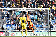 AFC Wimbledon goalkeeper Aaron Ramsdale (35) makes an important save during the EFL Sky Bet League 1 match between Oxford United and AFC Wimbledon at the Kassam Stadium, Oxford, England on 13 April 2019.