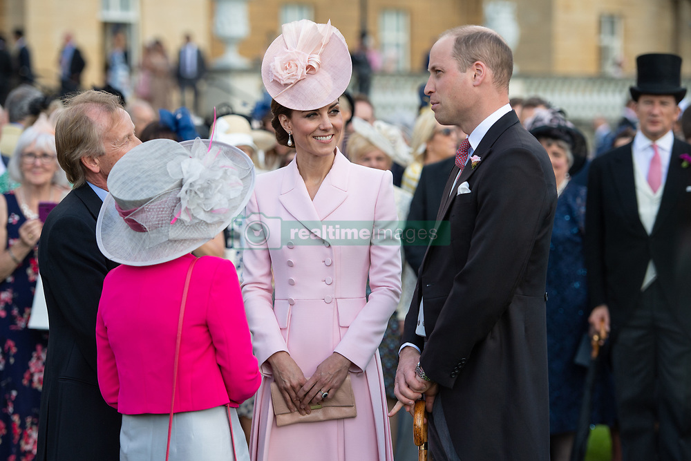 The Duke and Duchess of Cambridge meet guests attending the Royal Garden Party at Buckingham Palace in London.